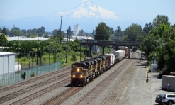 A UP freight with Mount Hood in the background.