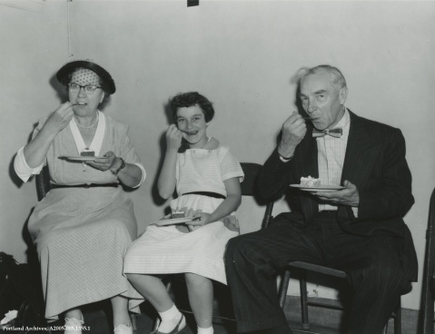 People eating cake at Carruther's retirement party, 1957 : A2005-005.1355.1